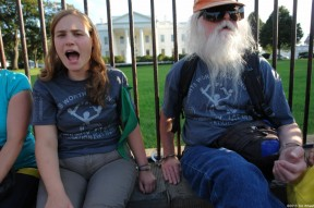 Allegra Stout protests outside the White House with a leader