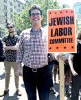 "Ari Fertig holds sign that says ""Jewish Labor Committee"""