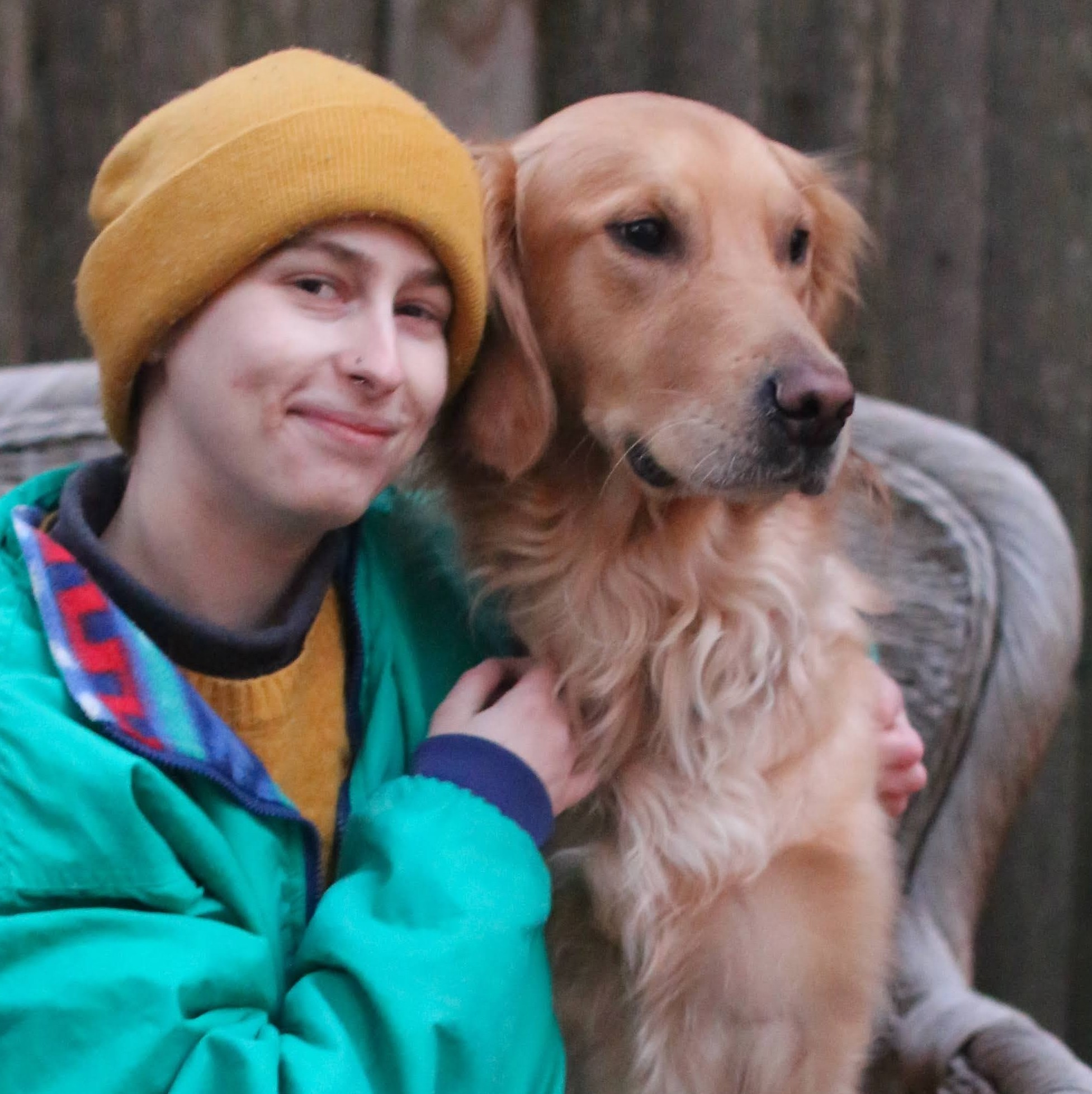 photo of Kayla Neumeyer with her dog Miles a golden retriever