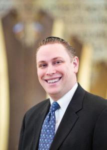headshot of Rabbi Jeffrey Abraham