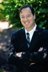 headshot of Rabbi Michael Alper